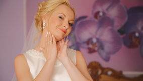 Young bride in lace wedding dress laughing at home stock footage