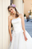 Young Bride Leaning Against a Pillar Royalty Free Stock Photo