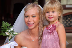 Young bride and little girl smile Royalty Free Stock Photo