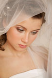 Young bride is looking down Stock Photos