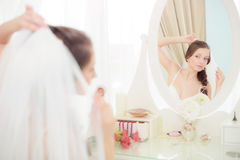Young bride near the mirror Stock Photos
