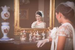 Young Bride looking herself at the mirror. Royalty Free Stock Photos
