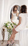 Young bride looking in mirror Royalty Free Stock Photo