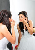 Young bride looking in mirror Royalty Free Stock Images