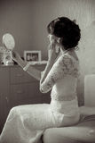 Young bride looking in the mirror Royalty Free Stock Photo