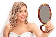 Young bride looking in a mirror Stock Image