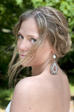A Young Bride looks back over her shoulder. royalty free stock image
