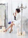 Young bride looks in the mirror. Bridal morning. Gentle young bride looks in the mirror. Bridal morning Royalty Free Stock Images