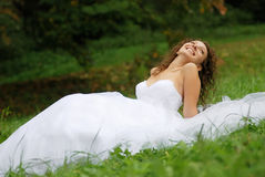 Young bride lying Stock Image