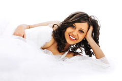 Young bride. Lying in bed isolated on white background royalty free stock photo