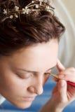 Young bride make-up stock photos