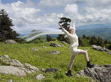 Young bride on mountain top Stock Photo