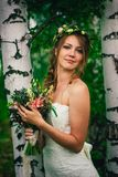 Young bride near birches in the forest stock photos
