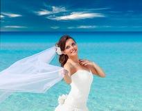 Young bride near blue sea Stock Photography