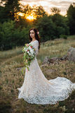 Young bride outside on a summer meadow at the sunset Royalty Free Stock Photo