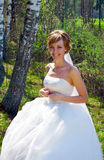 Young bride in park royalty free stock photo
