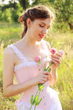Young bride in a pink corset outdoors Royalty Free Stock Photos