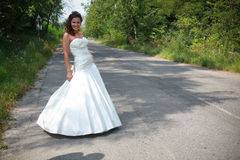 Young bride portrait. Caucasian bride posing on the street royalty free stock image
