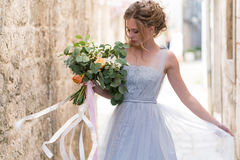 Young bride portrait with a wedding bouquet Stock Images