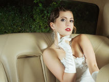 A young bride posing in a car Royalty Free Stock Images