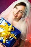 Young bride with a present Stock Photos