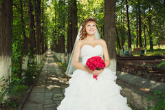 Young bride with red bouquet Royalty Free Stock Photo