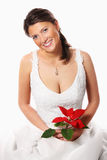 Young bride with a red flower Royalty Free Stock Photo