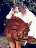 Young bride riding on red horse Stock Photography