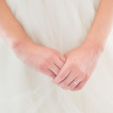 Young bride's hands with engagement ring Royalty Free Stock Image