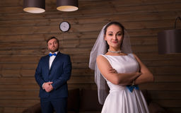 Young bride and serious groom on photo shoot Stock Photos
