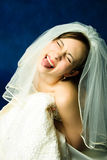 Young bride showing her tongue Royalty Free Stock Photography