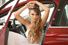 Young bride sits in car Royalty Free Stock Photography