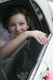 Young bride smile in a limousine Royalty Free Stock Photo