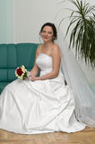 Young bride on sofa royalty free stock photo
