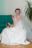 Young bride on sofa Royalty Free Stock Photography