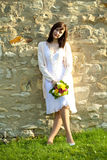 young bride standing at the wall Royalty Free Stock Images