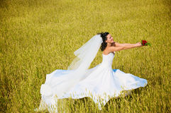 Young bride in the summer day Stock Photos
