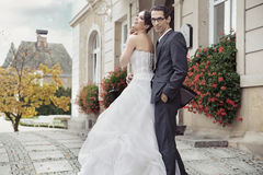 Young bride in tender hug. Young bride in men's tender hug Royalty Free Stock Photography