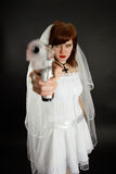 Young bride threatens us with a gun Stock Photography