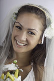 Young bride in veil with bouquet Royalty Free Stock Photography