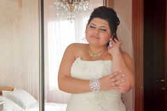 Young bride waiting for her groom royalty free stock image