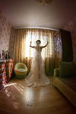 Young bride waiting for her groom stock photos