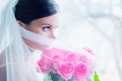Young bride waits for groom near the window Royalty Free Stock Photo