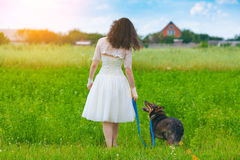 Young bride walking with dog Royalty Free Stock Photography