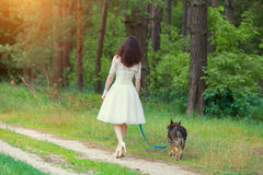 Young bride walking with dog Stock Photo