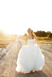Young Bride Walking On A Country Road Stock Photos
