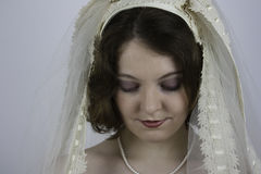 Young bride wearing vintage veil. Beautiful young bride wearing vintage veil and looking down Stock Photography