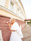 Young bride in wedding dress holding bouquet Stock Photography