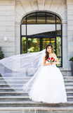 Young bride in wedding dress holding bouquet Royalty Free Stock Photo