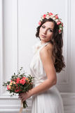 Young bride in wedding dress holding bouquet Stock Photo